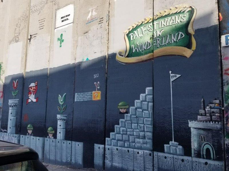 イスラエル旅行・ベツレヘムの分離壁に描かれた落書きアート